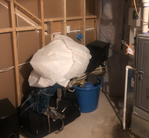 Debris in basement of Salt Lake City home that needs to be removed or picked up by professionals